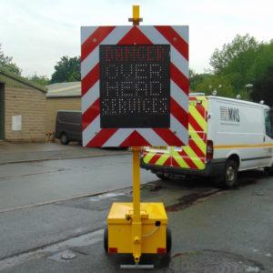 over head warning sign